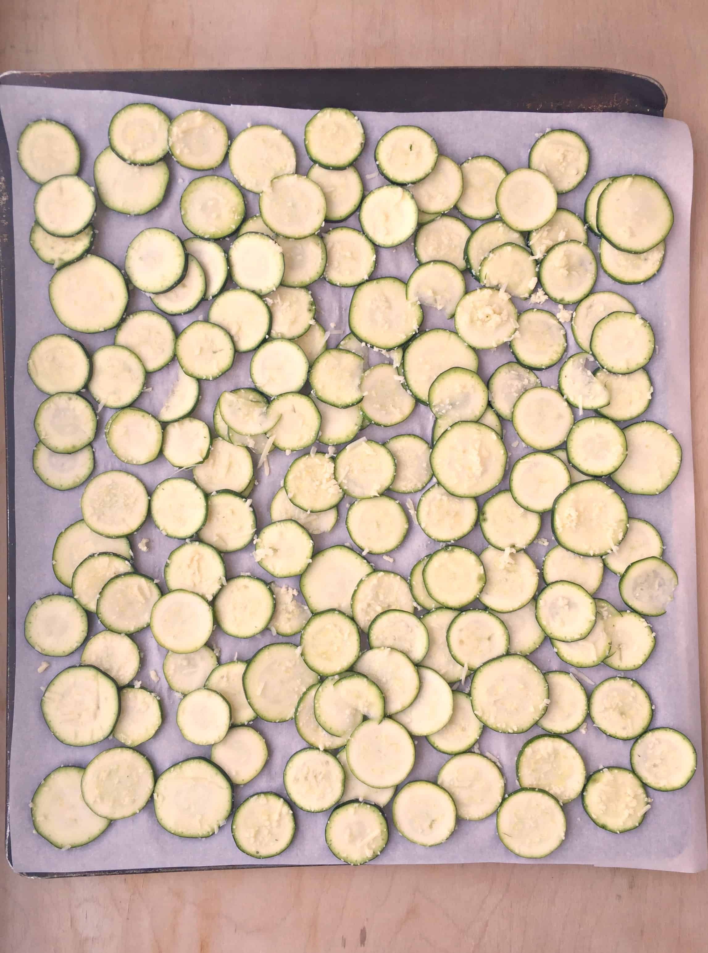 sliced zucchini chips on a pan