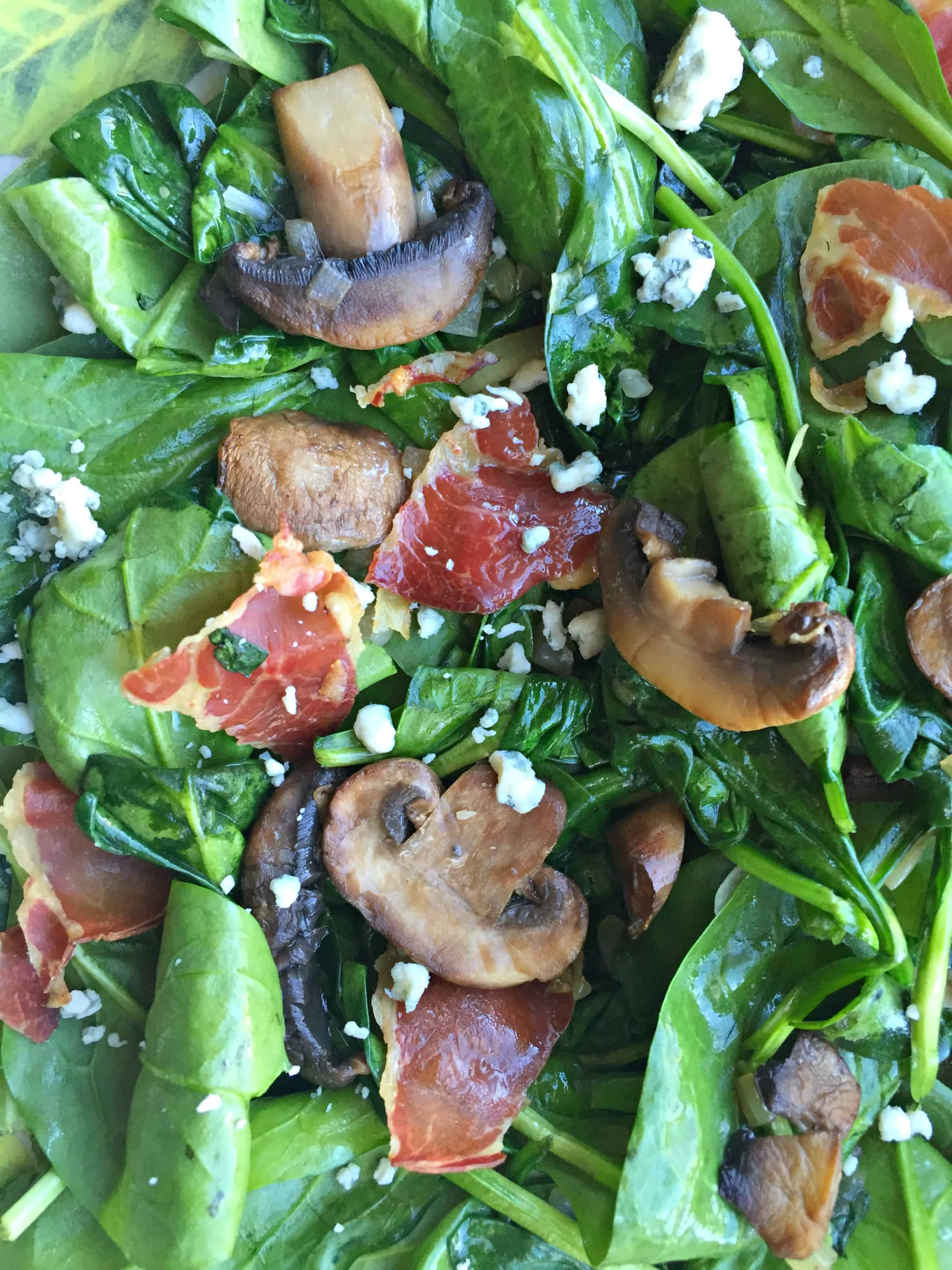 Add the spinach to the mushroom skillet and let it wilt just a little ...