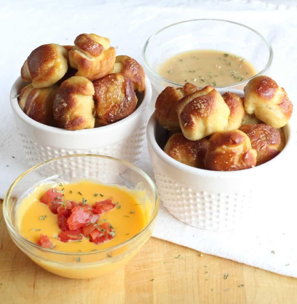 pretzel bites served with dipping sauces