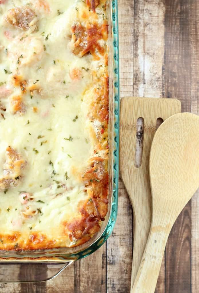 shrimp scampi lasagna with wooden serving utensils