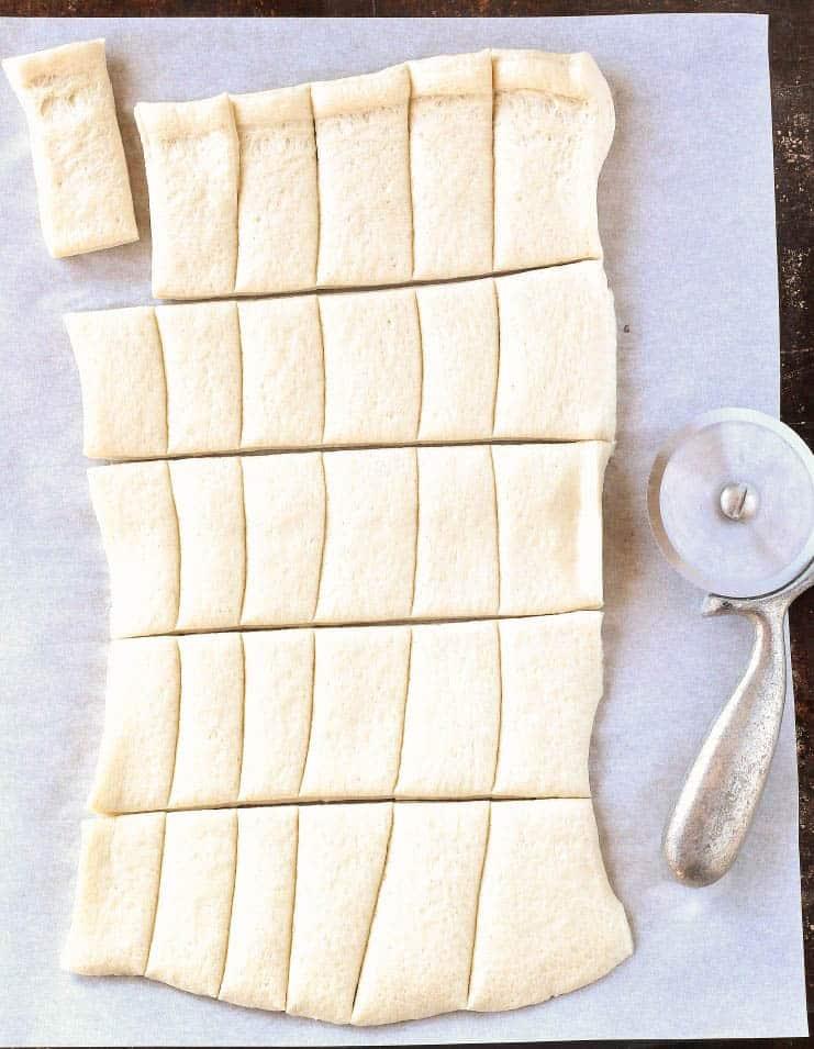 pizza dough cut into squares