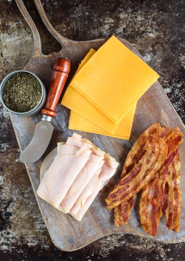 turkey club roll-ups ingredients on platter