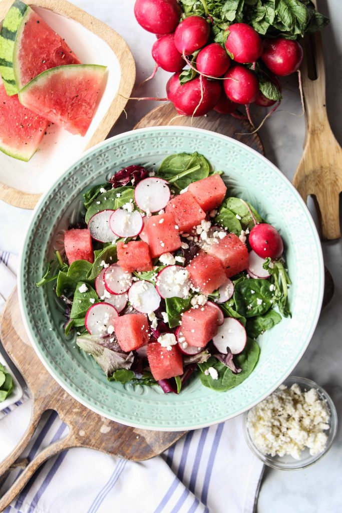 Watermelon, Radish, and Feta Salad in a bowl with ingredients