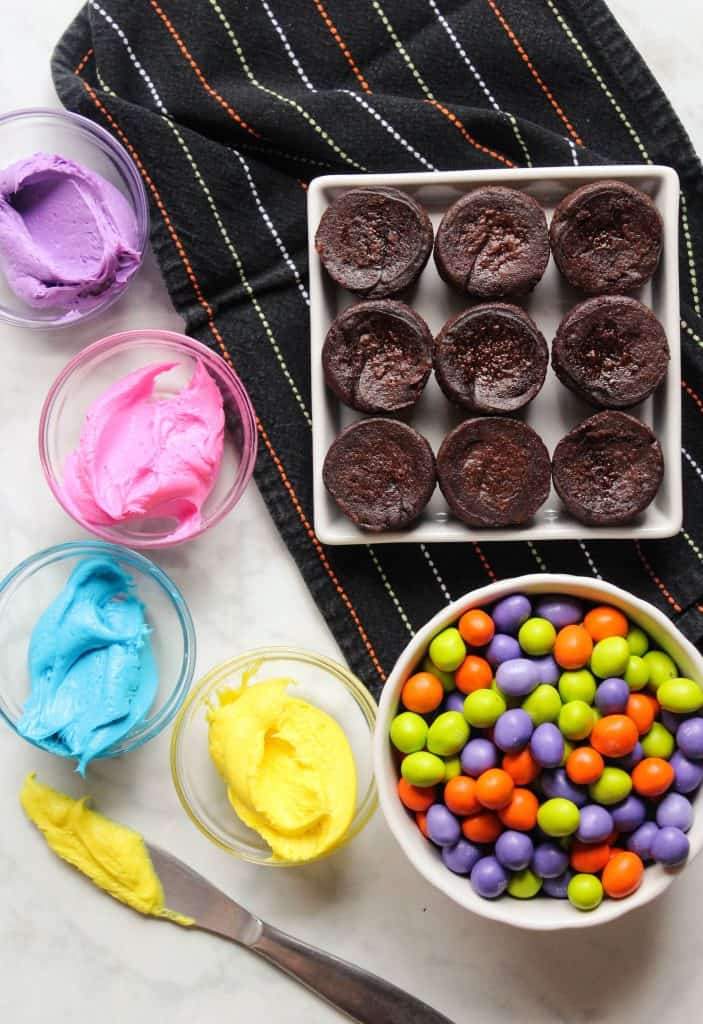mini brownies with colorful frosting