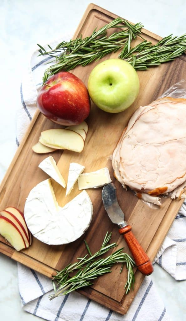 Turkey, Apples, and Brie cheese on a cutting board