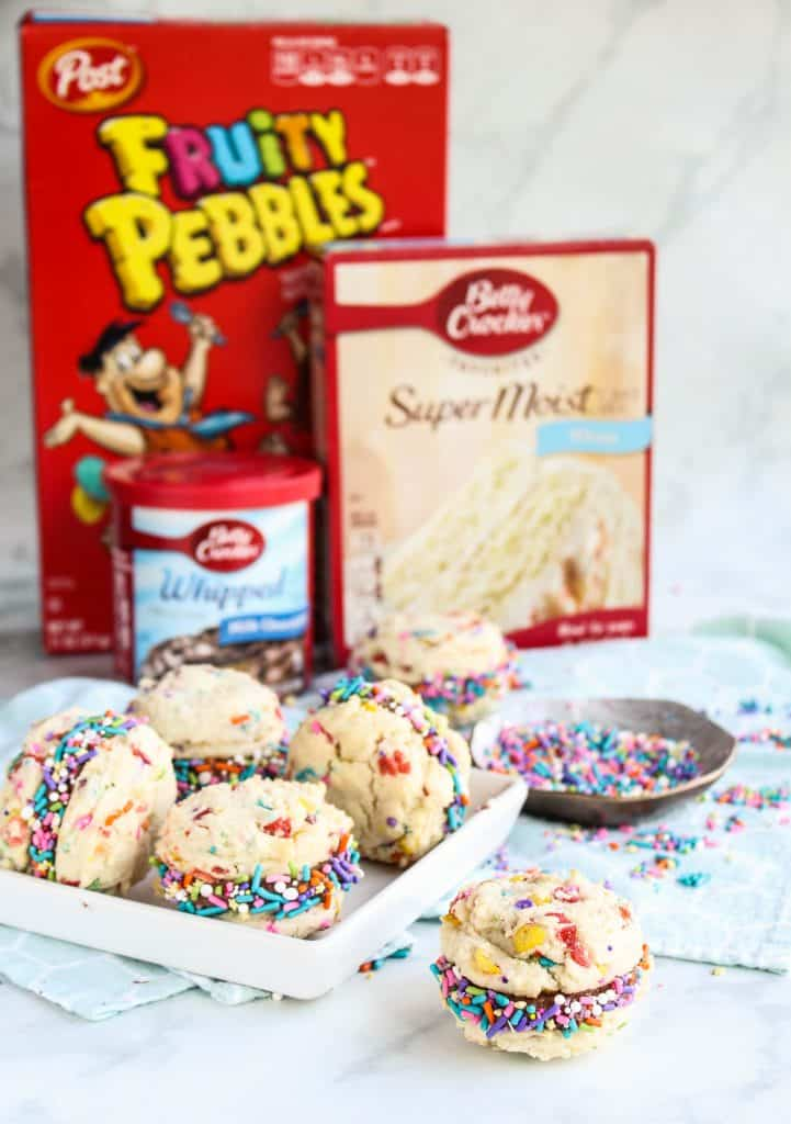 Fruity Pebbles Cookie Sandwiches with Chocolate Frosting and sprinkles