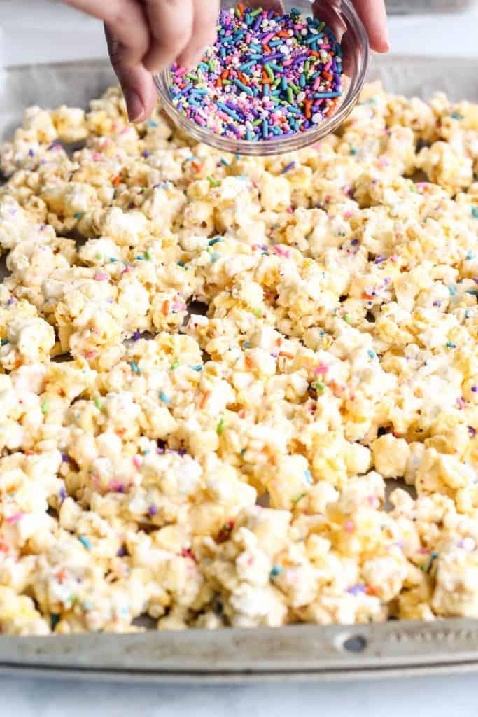 adding sprinkles to popcorn
