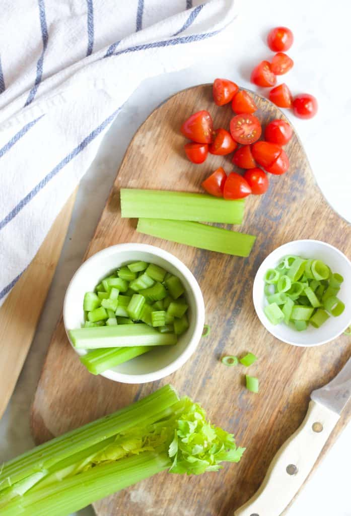 veggies cut up on a cutting board