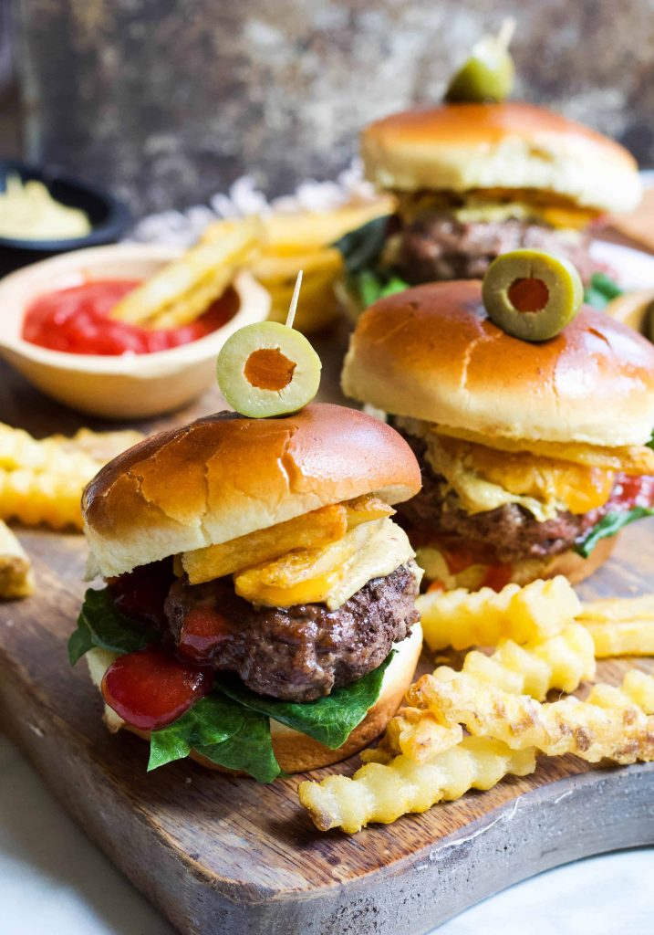 Mini Burger Sliders on a cutting board with fries and ketchup