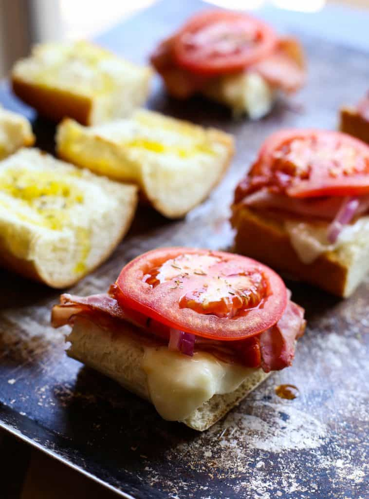 italian sub sandwich topped with tomato