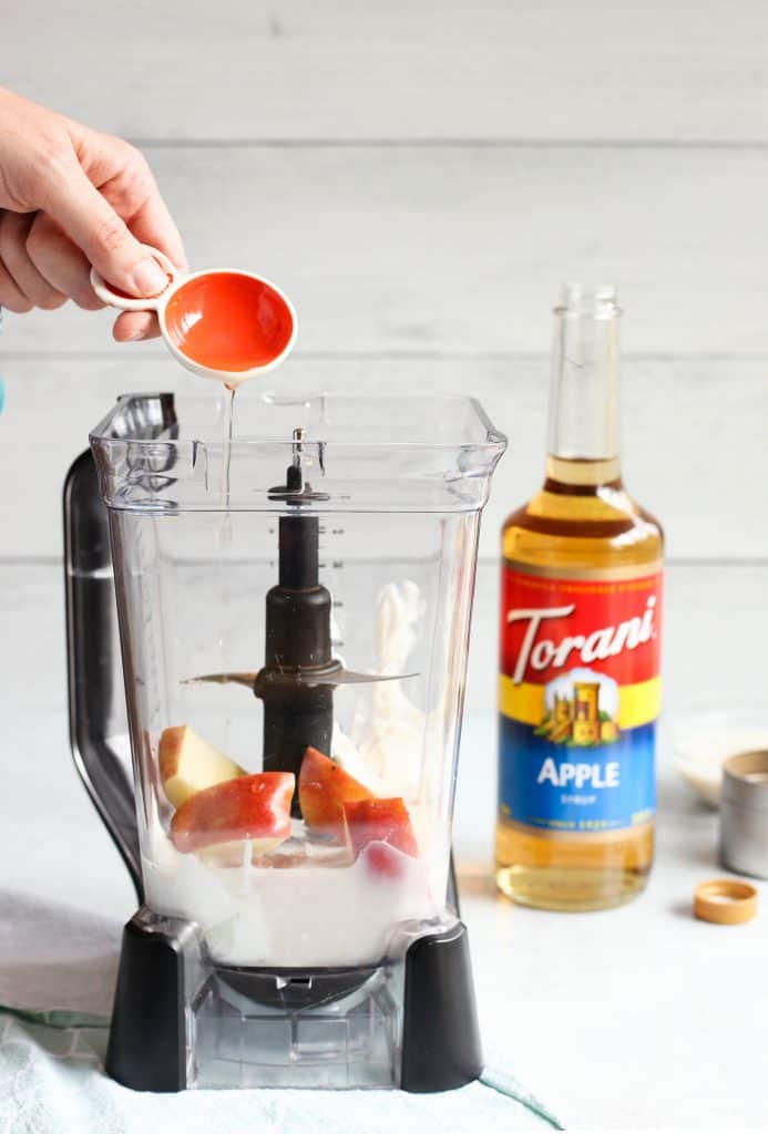 adding Torani apple syrup to blender
