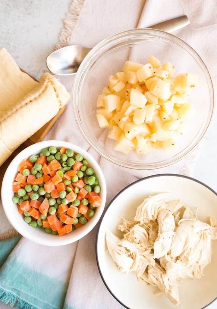 ingredients for Creamy Chicken Pot Pie Casserole in bowls
