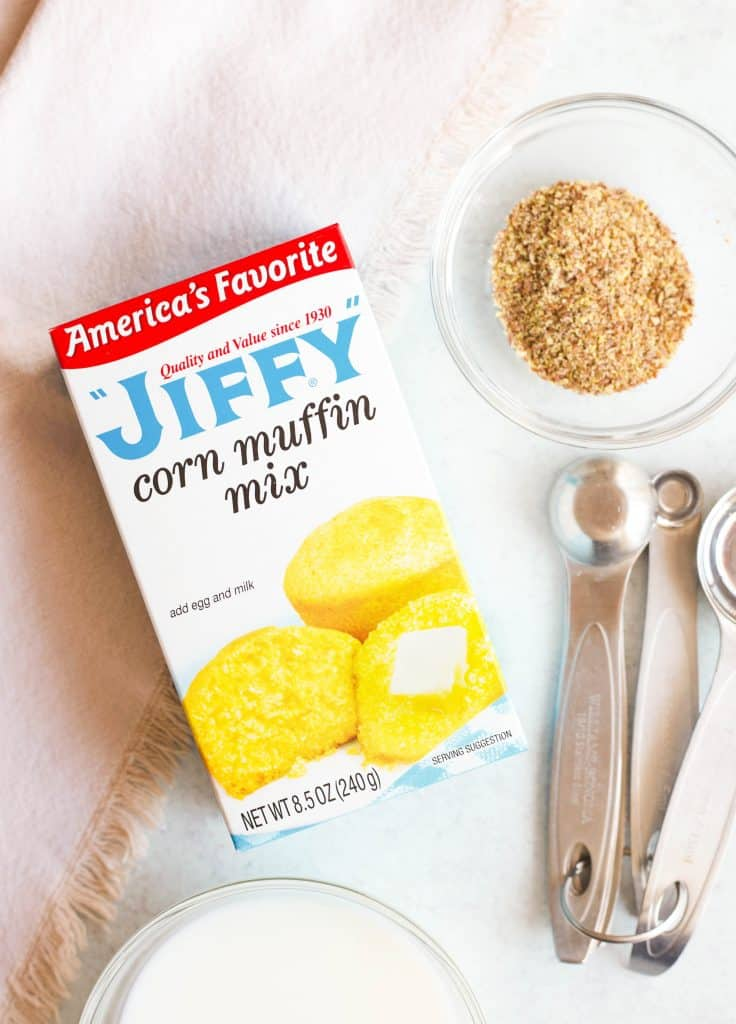 Jiffy corn muffin mix and flax seed in a bowl