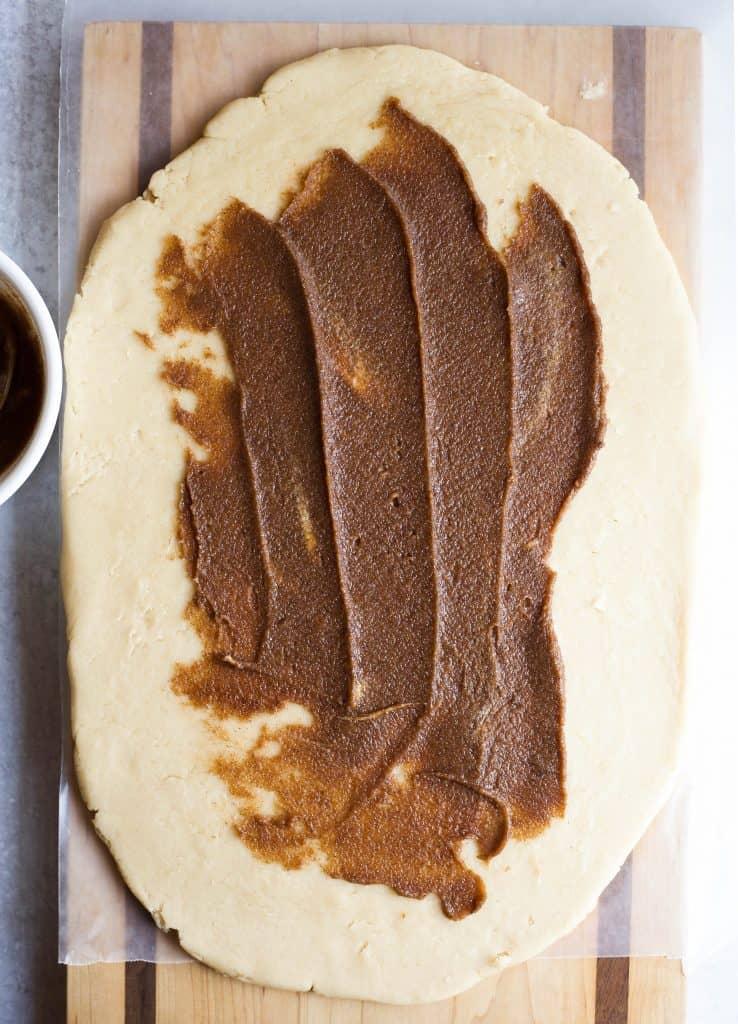 cinnamon sugar filling spread on dough
