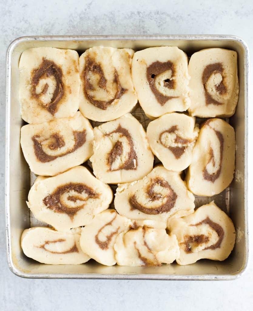 cut cinnamon rolls in a pan